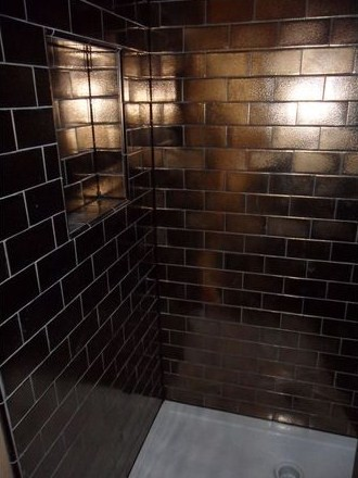 gold shower with hand made tiles