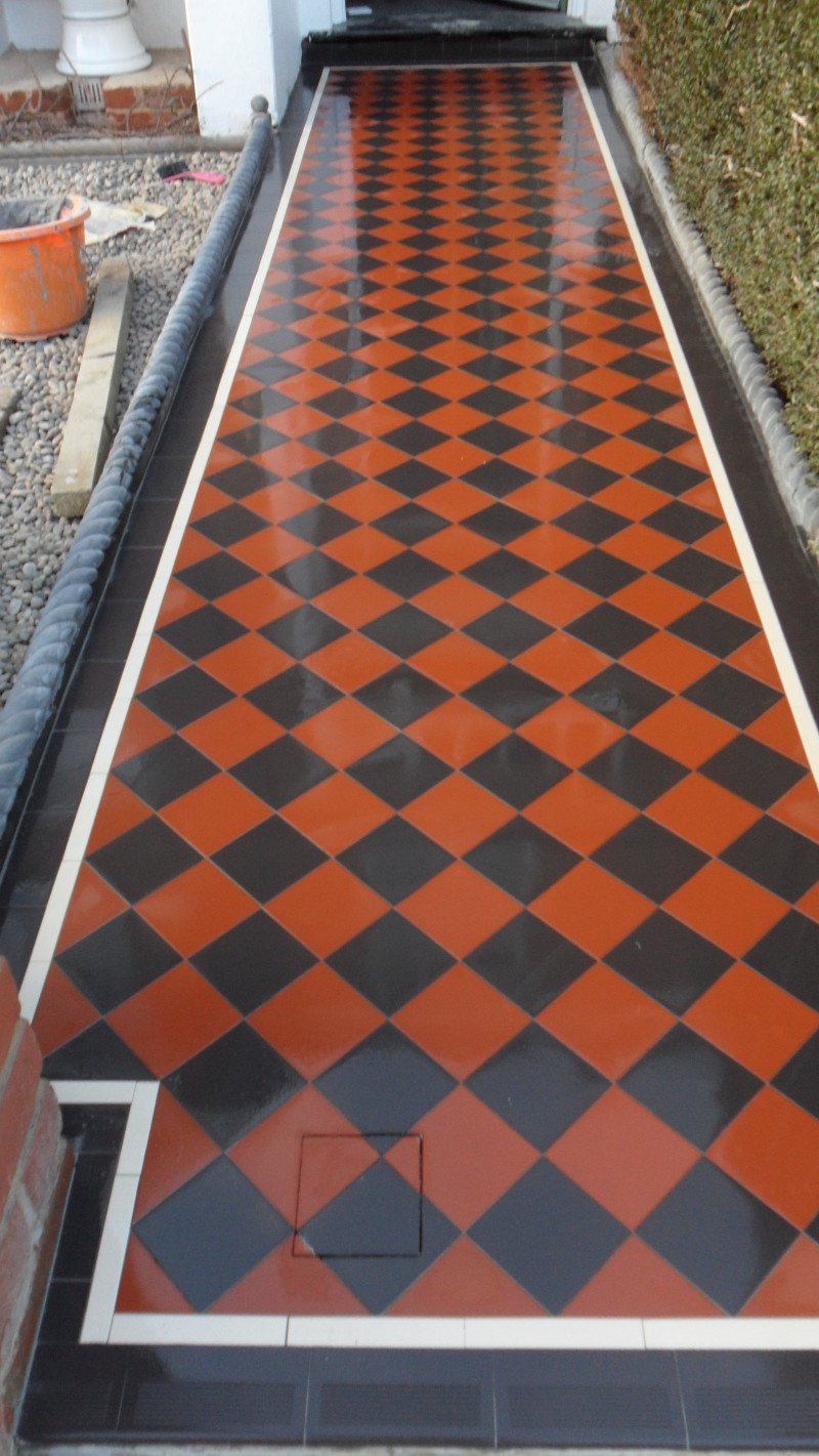 Red and black 10 x 10 Victorian design with Creme border (installed in Barnet London)