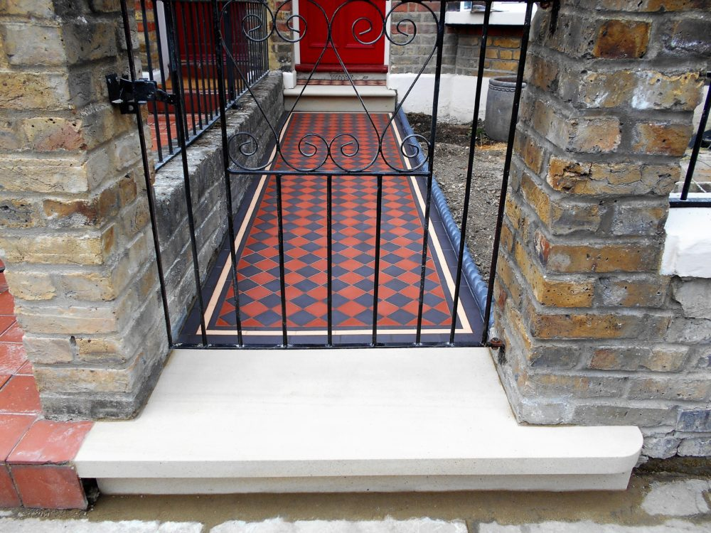 In this step we had to very carefully cut it around the pillars. These brick pillars where sitting on the old York stone slab which we had to cut out. & York Stone front door steps London - Expert Tilers North London Pezcame.Com